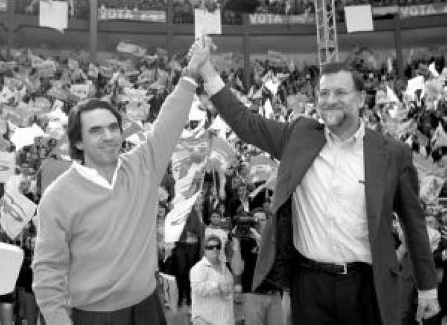 Aznar y Rajoy, juntos en el mitin de León